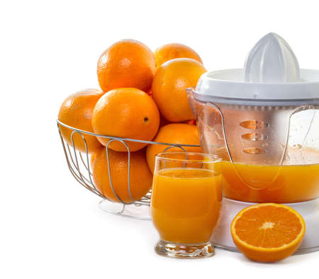 extractor: juice extractor with juice and ripe oranges  Stock Photo