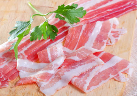 Appetizing bacon on the wooden background  photo
