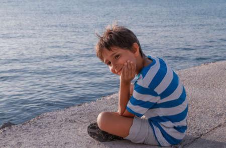 Portrait of a boy near the sea photo