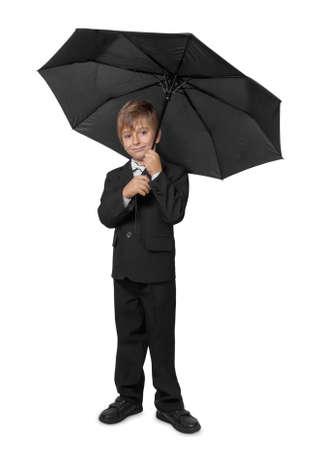 Boy in a tuxedo, under an umbrella. Isolate on white background. photo