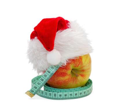 metro de medir: Apple con un metro de medici�n, con una gorra de Santa Claus