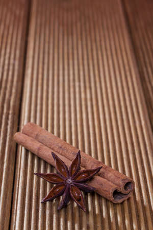 Cinnamon with anise on a wooden background photo