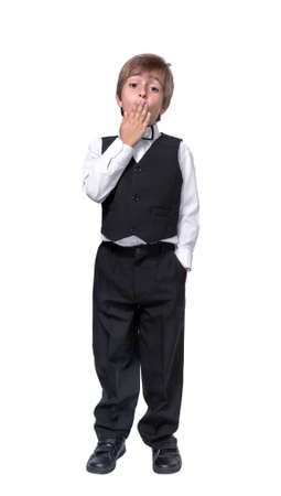 little boy in a tuxedo, isolate on white background photo