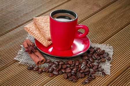 Coffee in a red cup with cinnamon and anise stars  photo