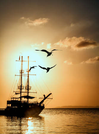 Ship silhouette at sunset  photo
