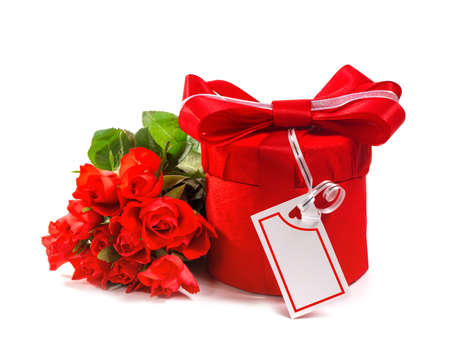 Red gift with a red bow and roses  Isolate on white background photo