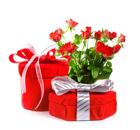 Red gift with a red bow and roses. Isolate on white background photo