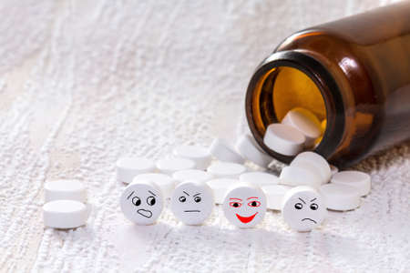 Tablets with smiley face in medical bottle photo