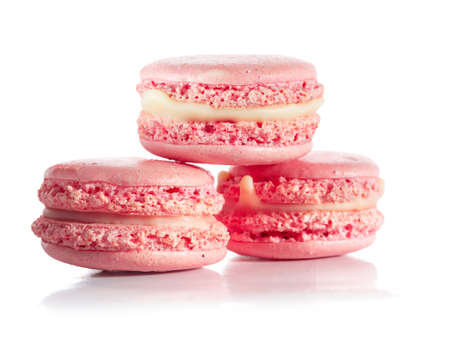 Pink French macarons isolated on white background photo
