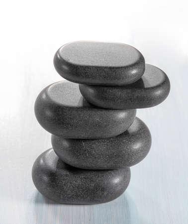 Zen stones on a wooden background photo