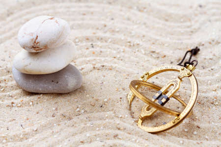 Sundial in the sand photo