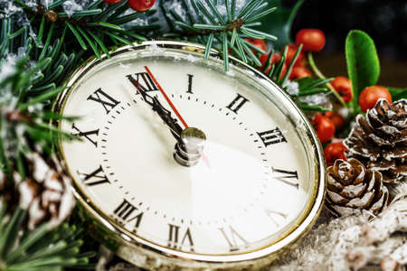 wooden clock: Christmas clock with winter decoration Stock Photo