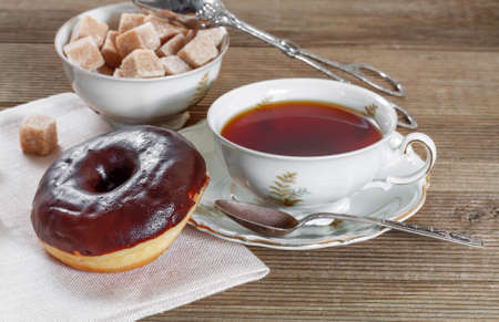 Chocolate donut with hot tea photo