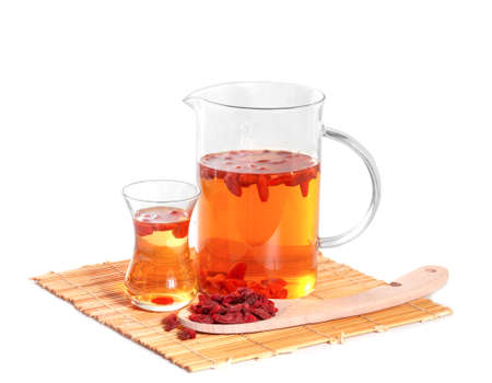 Infusion of goji berries with dry berries photo