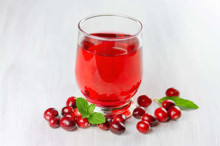 cystitis: Fresh cranberry juice. Small depth of field