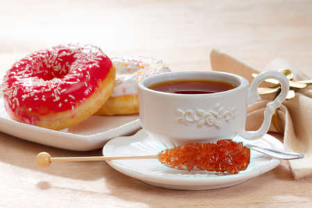 Hot tea with delicious doughnut photo