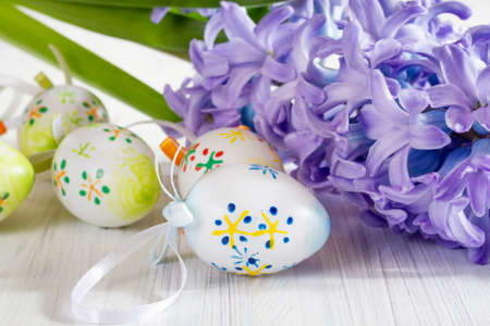 Ostern: Blue hyacinth with Ostern eggs