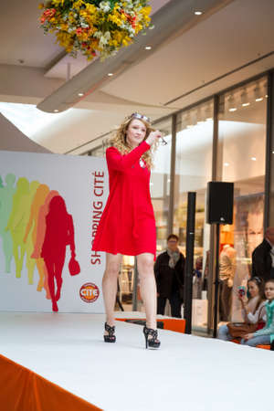 eveningwear: BADEN-BADEN, GERMANY - MARCH 7: Fashion model wearing clothes from the spring collection in a shopping center Cité on March 7, 2015 in Baden-Baden. Germany. Europe.