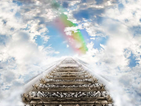 surrealist: Railroad leading to the cloudy sky and rainbow