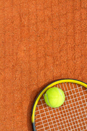 Sport background with a tennis racket and ball. Vertical image.