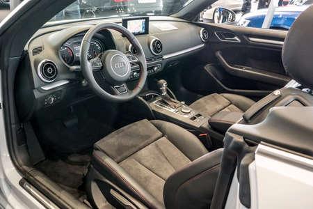 dealers: Baden-Baden, Germany - October 10, 2015: New models of the brand Audi in a dealers showroom in Baden-Baden, Germany.  Interior Audi A3 Cabriolet Editorial