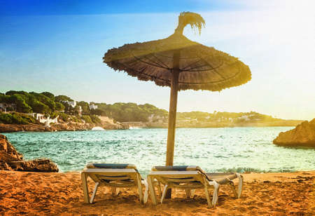 majorca: Scenic sunrise on the beach in Mallorca. Illustration in the style of watercolor paintings. Stock Photo