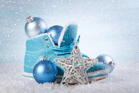 botas de navidad: Christmas background with boots and Christmas decorations Foto de archivo