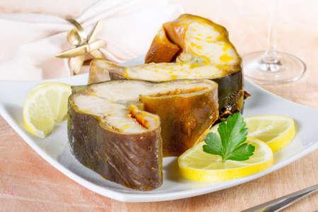 sturgeon: Smoked sturgeon fillet on a  platter Stock Photo