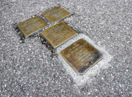 BADEN-BADEN, GERMANY  - FEBRUARY 27.  Stolperstein (Stumbling Block), a sculpture and monument created by Gunter Demling. Cobblestone-sized memorials on the pavements. Germany, Baden-Baden, February 27, 2016 Editoriali