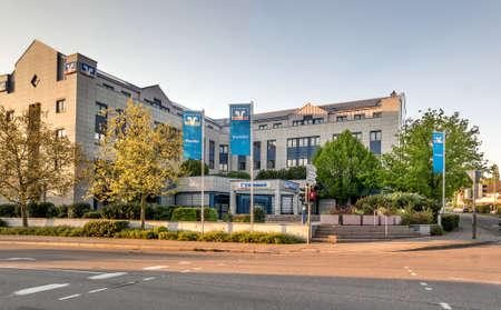economizing: BADEN-BADEN, GERMANY - MAY 2: Modern building facade with logo of the german banks named Volksbank. Germany, Baden-Baden, May 2, 2016 Editorial