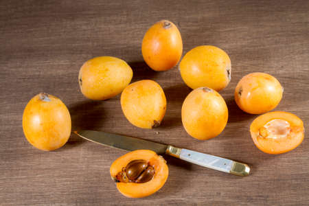 Loquats On Wooden Background. Vintage Style Stock Photo   58467162