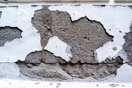 rend: Old wall with damaged plaster layer Stock Photo