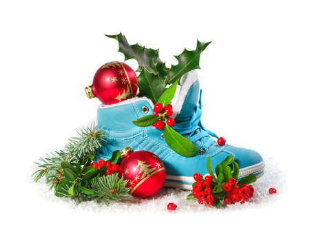 Blue shoe with Christmas decorations  isolated on white background.  Christmas concept.