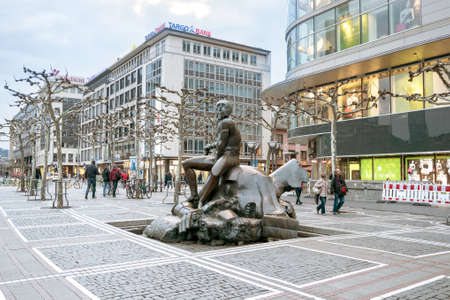 FRANKFURT AM MAIN, GERMANY - April 1, 2018: Pedestrian zone in the center of Frankfurt.  Contemporary sculpture. Richard Hess created the sculpture David and Goliath in 1983.