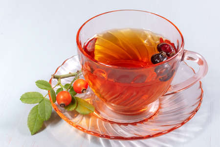 cup of rosehip tea on a wooden table