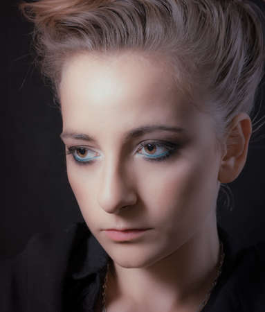 Portrait of a young woman on a black background Imagens
