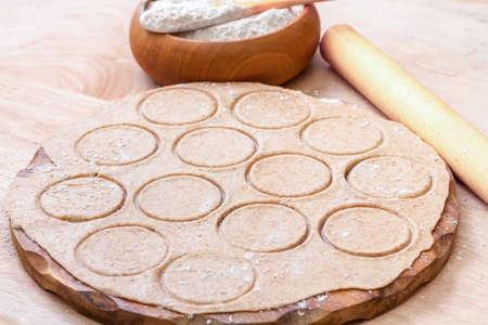 Dough circle ready to prepare  Italian tortellini.