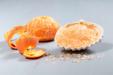 Citrus bath salt with fresh tangerines on a wooden table Imagens