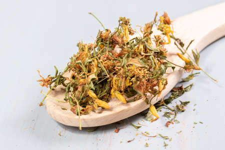 pile of dried hypericum on a wooden table