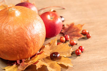 Autumn, autumn leaves, pumpkin and apples on a wooden table background. Imagens