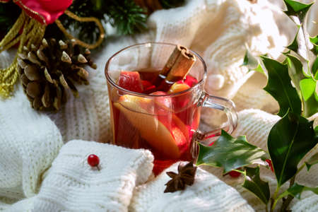 Hot punch, warm sweater and Christmas  decorations