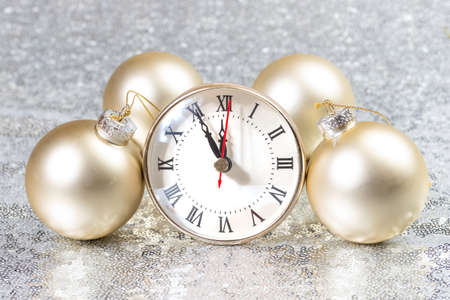 New Year card with Christmas balls and clock.