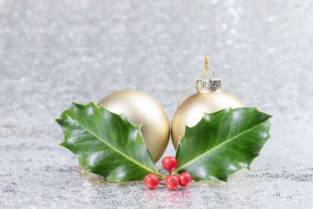 Christmas card with christmas balls and holly leaves Imagens