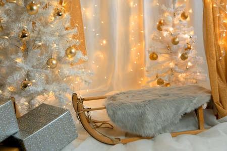 Christmas interior with christmas tree and sled.