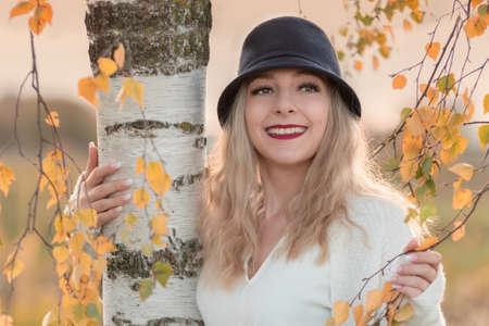 Autumn portrait of a young blonde woman