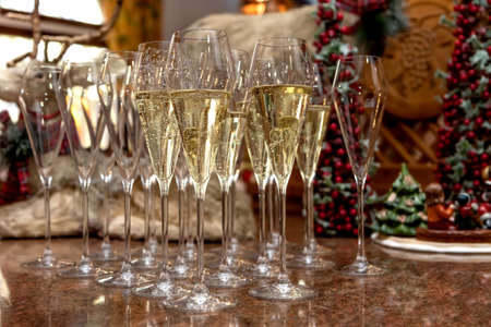 Champagne glasses in Christmas decorations Imagens