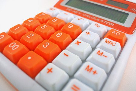 reckon: Calculator close-up shot focus on white background