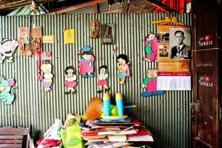 thai people: Thai people house wall, Thailand Editorial