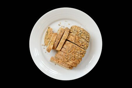 Baked bread on a white plate, Black Background isolated Banque d'images