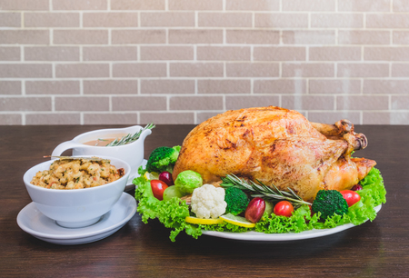 Roasted turkey stuffing garnished with Vegetables served with gravy sauce on a rustic style table. Christmas Dinner Banque d'images
